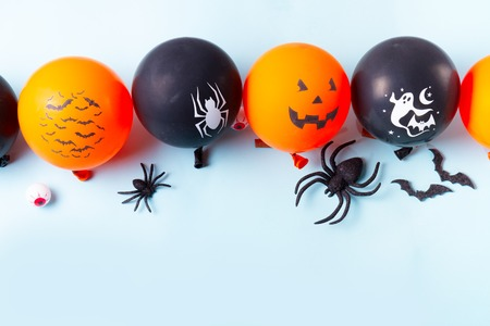 Halloween scene with balloons border on blue background