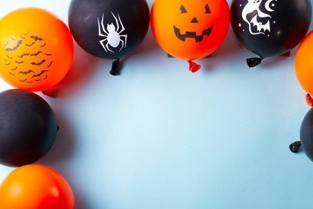 Halloween top view scene with balloons on blue background