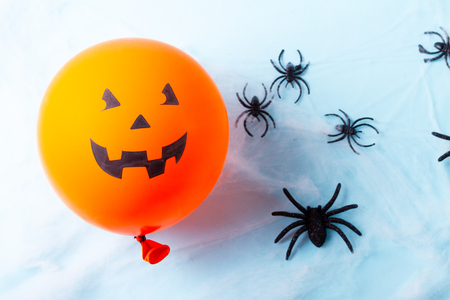 Halloween scene with scary balloon on blue background Stock Photo