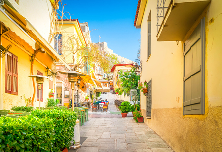 Small cosy street of famous Placa old town district in Athens, Greece, toned
