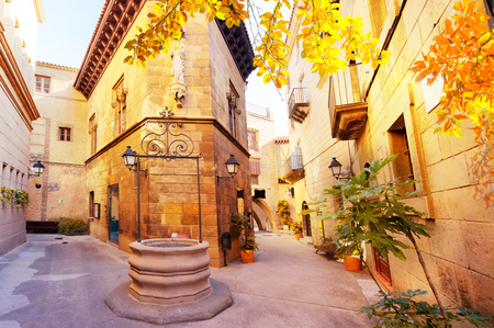 Poble Espanyol stone pedestrian street, traditional architecture site in Barcelona, Catalonia Spain at fall