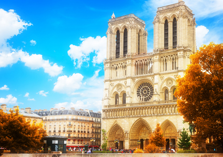 Notre Dame cathedral facade in Paris, France at fall