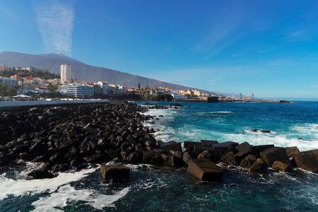 skyline of Puerto de la Cruz with Teide volcano and Atlantic ocean, Tenerife, Spain Фото со стока