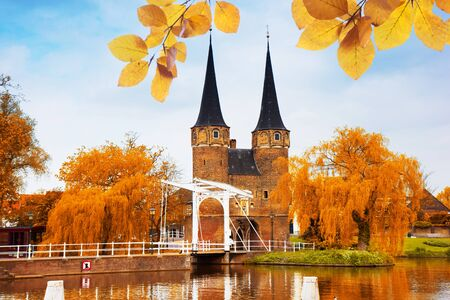 East gate with typical bridge, Delft, Netherlands at fall