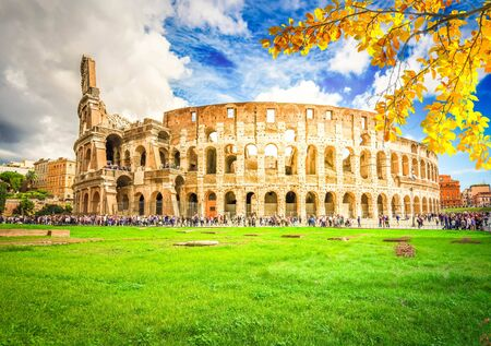 Ruins of antique Colosseum building at fall day in Rome Italy