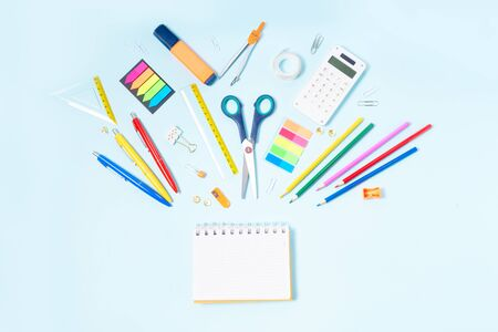 Back to school concept with colorful school supplies on blue Foto de archivo