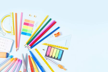 Back to school concept with colorful school supplies border on blue 스톡 콘텐츠