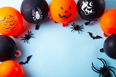 Halloween top view scene with balloons and spiders on blue background