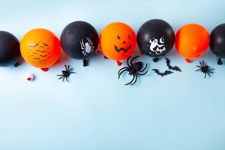 Halloween scene with balloons and spiders border on blue background 写真素材