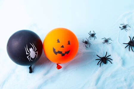 Halloween scene with to scary balloons on blue background 写真素材