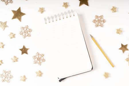 Wish list for Cristmas and New Year. Holiday decorations and ruled notebook with wish list on white desk, flat lay Banco de Imagens