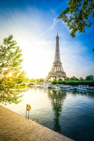 Paris Eiffel Tower and river Seine at sunrise in Paris, France. Eiffel Tower is one of the most iconic landmarks of Paris, retro toned Stock Photo