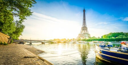 Paris Eiffel Tower reflecting in river Seine at sunrise in Paris, France. Web banner format. Eiffel Tower is one of the most iconic landmarks of Paris, retro toned Stock Photo