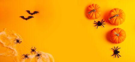 Halloween flat lay top view frame on orange background with copy space, web banner format