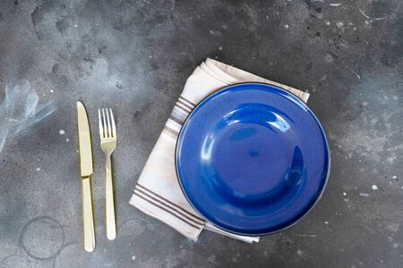 Abstract food background with blue plate over black kitchen table Stok Fotoğraf