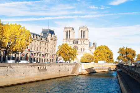 Notre Dame cathedral on Cite island over the Seine river, Paris cityscape at fall, France Stock fotó