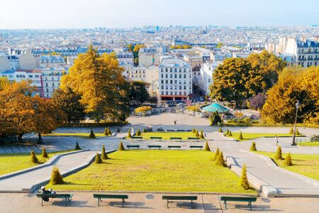 view of romantic Monmartre and skyline of Paris city, France at fal