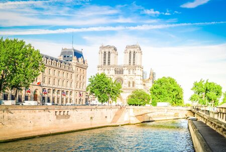Notre Dame cathedral on Cite island over the Seine river, Paris cityscape at summer, France, toned