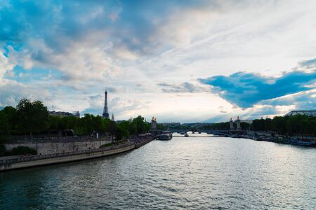 famouse Alexandre III Bridge details and Eiffel Tower with dramatic sky, Paris, France 스톡 콘텐츠