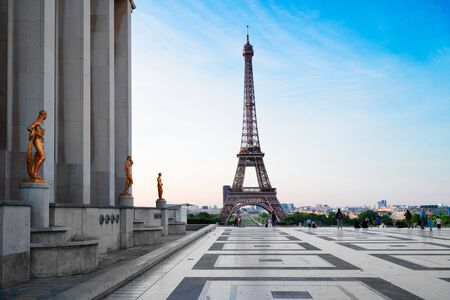 Paris Eiffel Tower and Trocadero square at sunset in Paris, France. Eiffel Tower is one of the most iconic landmarks of Paris.