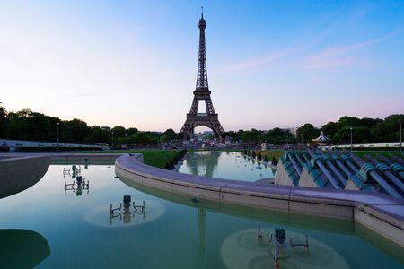 Paris Eiffel Tower and Trocadero garden at sunset in Paris, France. Eiffel Tower is one of the most iconic landmarks of Paris.