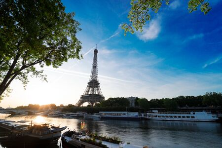 Paris Eiffel Tower and famous river Seine at sunrise in Paris, France. Eiffel Tower is one of the most iconic landmarks of Paris. 스톡 콘텐츠