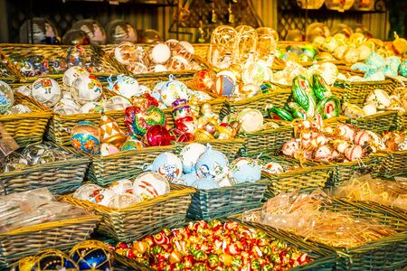 Christmas market stall details with wide choice of christmas tree decorations, toned