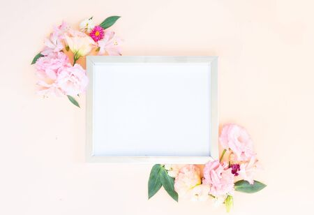 Flowers composition. Frame with lilly and eustoma flowers on pink background. Flat lay, top view scene. Stock Photo