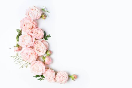 Floral composition with pink rose and ranunculus flowers on white background. Flat lay, top view, copy space