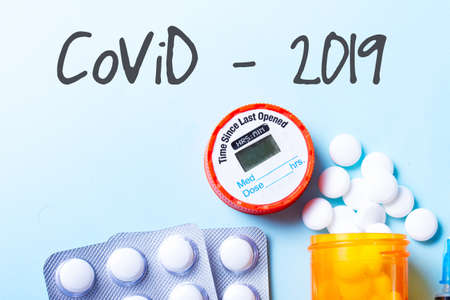 Healthcare concept - white pills medical border on blue with copy space, coronavirus covid 2019 concept