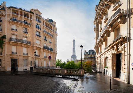 cosy Paris street with view on the famous Eiffel Tower on a cloudy summer day, Paris France
