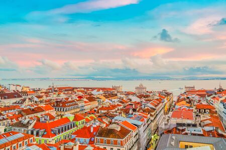 view of Lisbon over old town quarters at sunset, Lisbon Portugal, toned