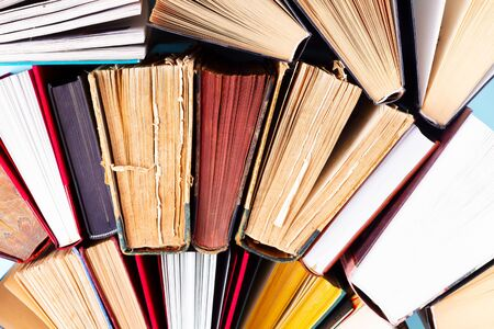 Pile of old books, close up top view background, education concept Zdjęcie Seryjne