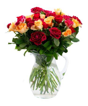 orange and red roses in glass vase Banco de Imagens
