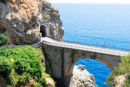 famous picturesque winding road and viaduct of Amalfi summer coast, Italy