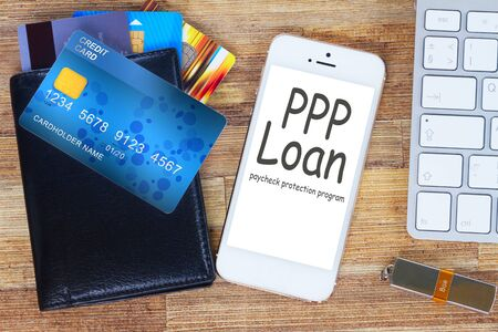 phone and wallet with cards, paycheck protection program concept