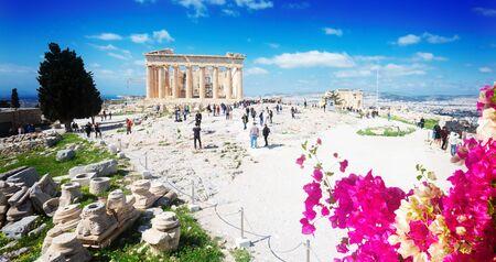 famous Parthenon temple and Athenian Acropolis, Acropolis hill with flowers, Athens Greece, web banner