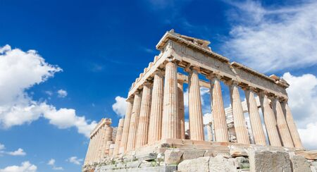 Parthenon temple over bright blue sky background, Acropolis hill, Athens Greece, web banner format