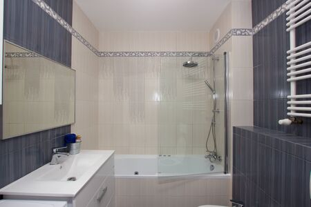 Moder bathroom in gray and white tiles