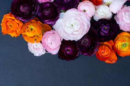 Flowers composition. Floral texture made of roses, orchids and ranunculus flowers, flat lay wiith copy space on card