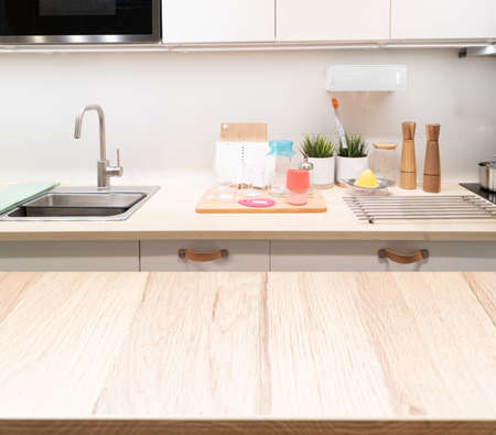 Wood counter top on blur kitchen room background .For montage product display or key visual layout.