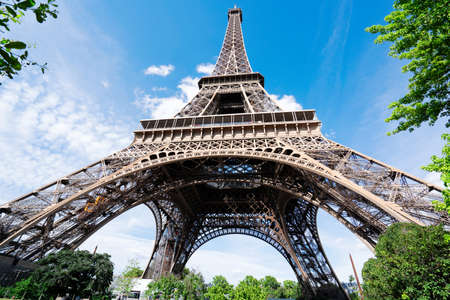 Paris famous landmarks. Eiffel Tower in blue sky, view upside down, Paris France