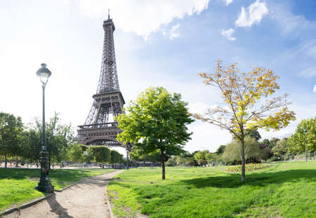 Paris Eiffel Tower with park pathway in Paris, France. Eiffel Tower is one of the most iconic landmarks of Paris.