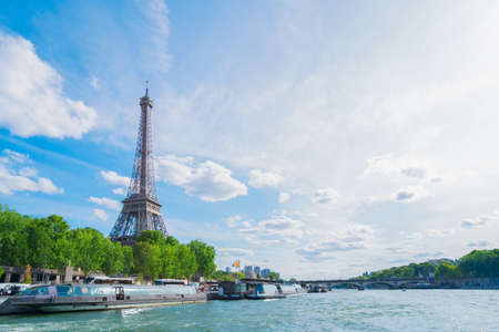 Eiffel Tower and Seine riverbank at summer day, Paris, France