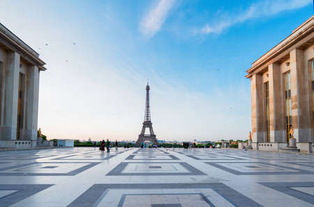 Paris Eiffel Tower and Trocadero square at sunrise in Paris, France. Eiffel Tower is one of the most iconic landmarks of Paris.