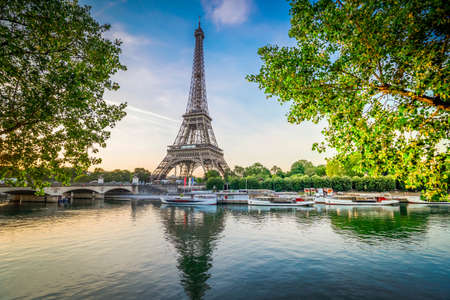 Paris Eiffel Tower and river Seine with sunrise in Paris, France. Eiffel Tower is one of the most iconic landmarks of Paris with sunshine Zdjęcie Seryjne