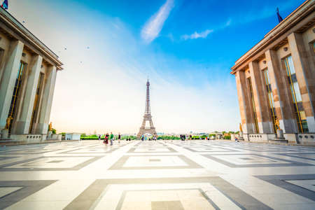 Paris Eiffel Tower and Trocadero square at sunset in Paris, France. Eiffel Tower is one of the most iconic landmarks of Paris with sunshine