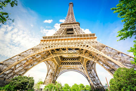 Paris famous landmarks. Eiffel Tower in blue sky, view upside down, Paris France with sunshine