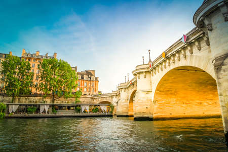 bridge Pont Neuf and Seine river with old houses, Paris, France with sunshine