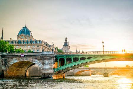 bridges of Paris and Seine river at sunny summer sunset, Paris, France with sunshine